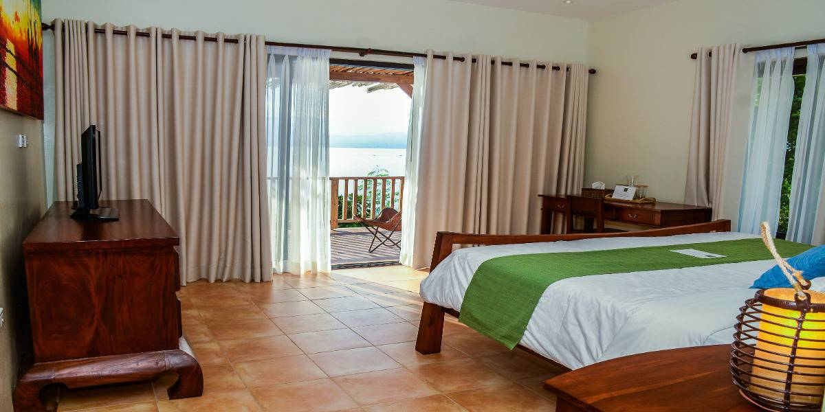 Bedroom 5: Below pool cabana with its own private balcony directly overlooking the marine sanctuary.