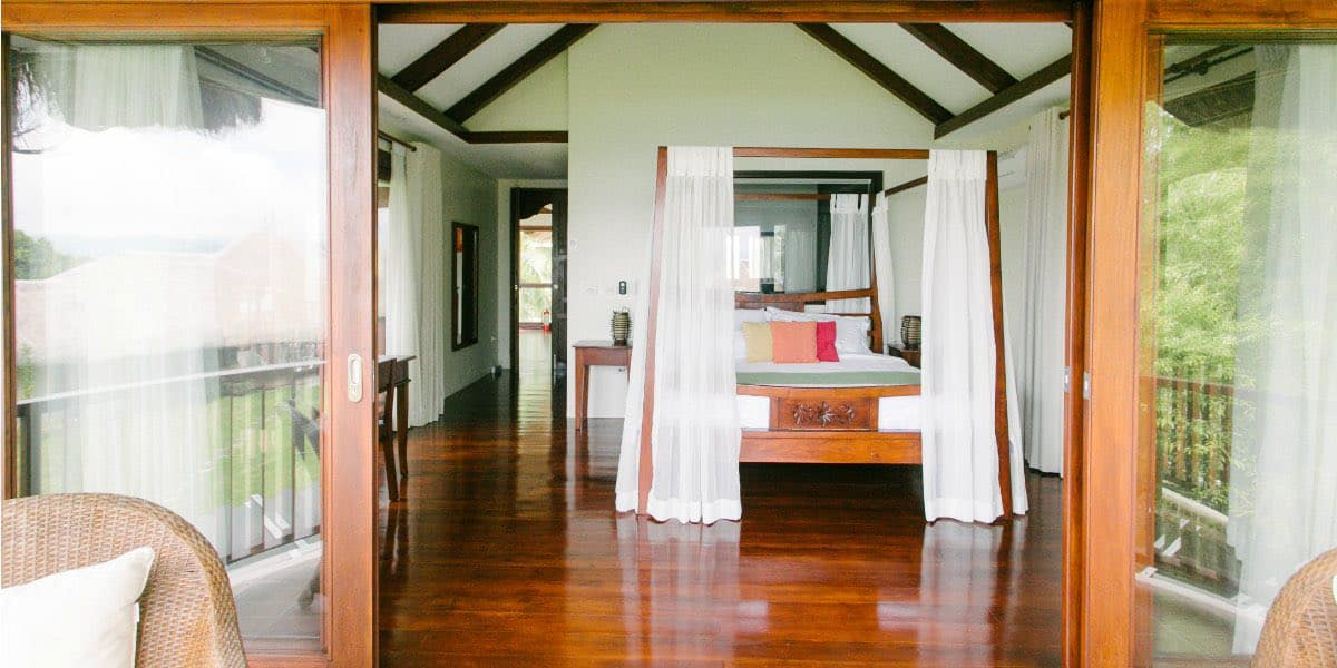 Bedroom 1: Your private sanctuary with a king-sized canopy bed.